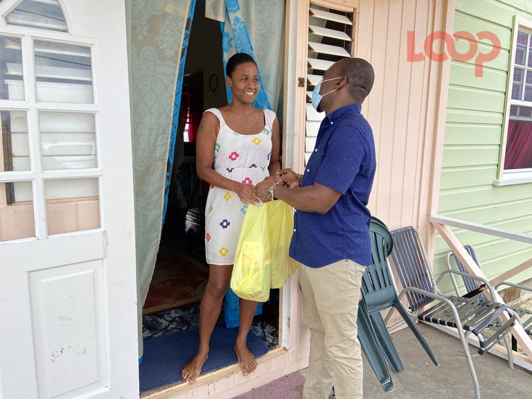 Simon Alleyne (right) presents Eastbourne, St Philip resident, Jaime Best with a food hamper