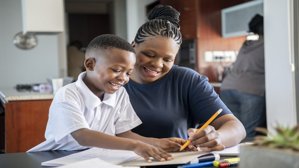 iStock photo of mother and son doing homework at a table.