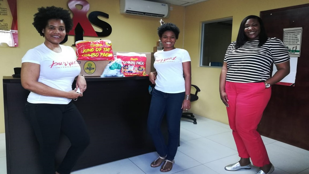 Stacy Ann Smith, (centre), director of Pursued International Foundation, poses with the organisation's outreach coordinator, Chriseve Smith