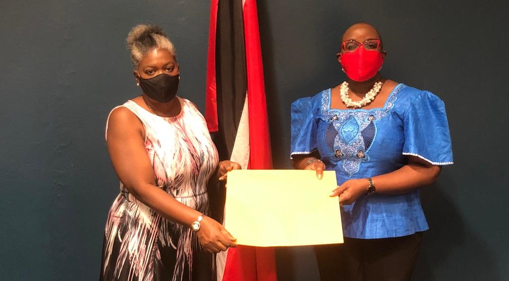Photo courtesy Ministry of Social Development and Family Services. From left to right, Petal Dawn Hinkson of the Cooperative Trustees of the Anglican Church; Minister Camille Robinson-Regis
