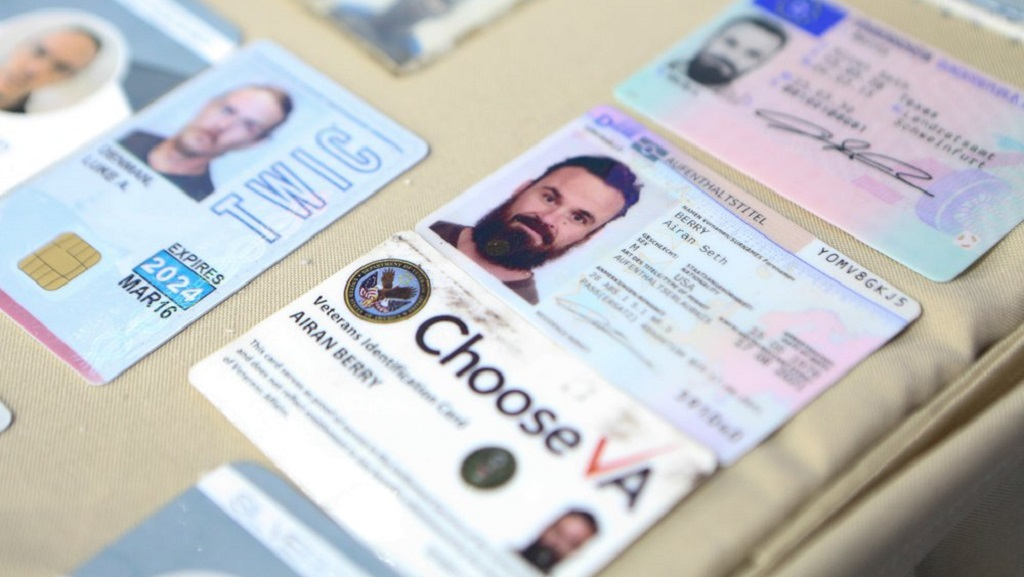This photo released by the Venezuelan Miraflores presidential press office shows what Venezuelan authorities identify as the the I.D. cards of former U.S. special forces citizen Airan Berry, right, and Luke Denman, left, in Caracas, Venezuela, Monday, May 4, 2020. (Miraflores Palace presidential press office via AP)