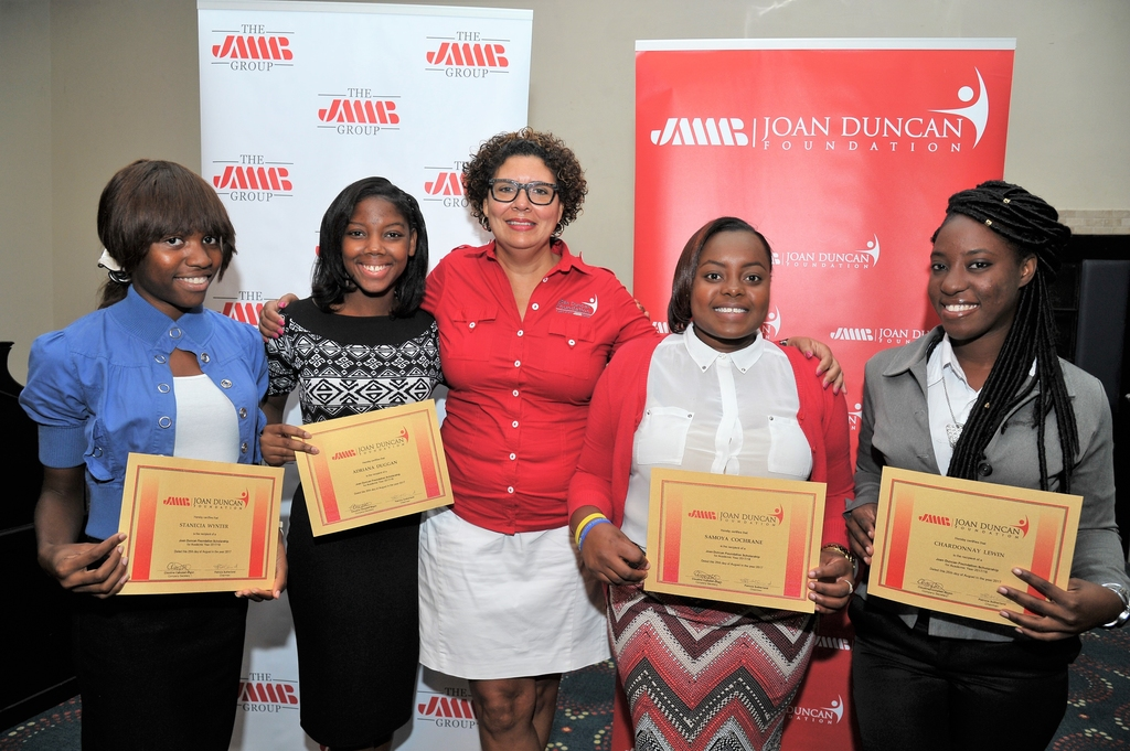 File photo shows Patricia Sutherland (centre), chairman of the JMMB Joan Duncan Foundation with past scholarship recipients.
