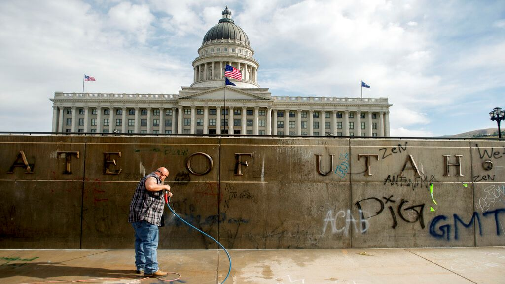 Don Gamble cleans up graffiti at the Capitol in Salt Lake City on Sunday, May 31, 2020, following protests over the death of George Floyd. (Jeremy Harmon/The Salt Lake Tribune via AP)