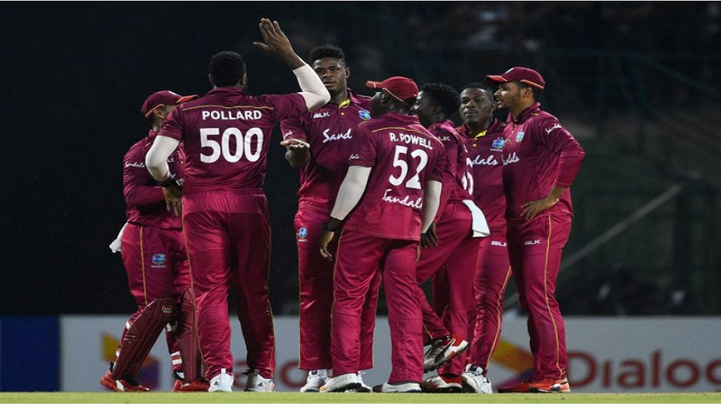 West Indies players celebrate.