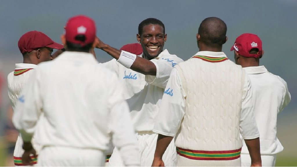Jermaine Lawson (centre) celebrates with his West Indies teammates.