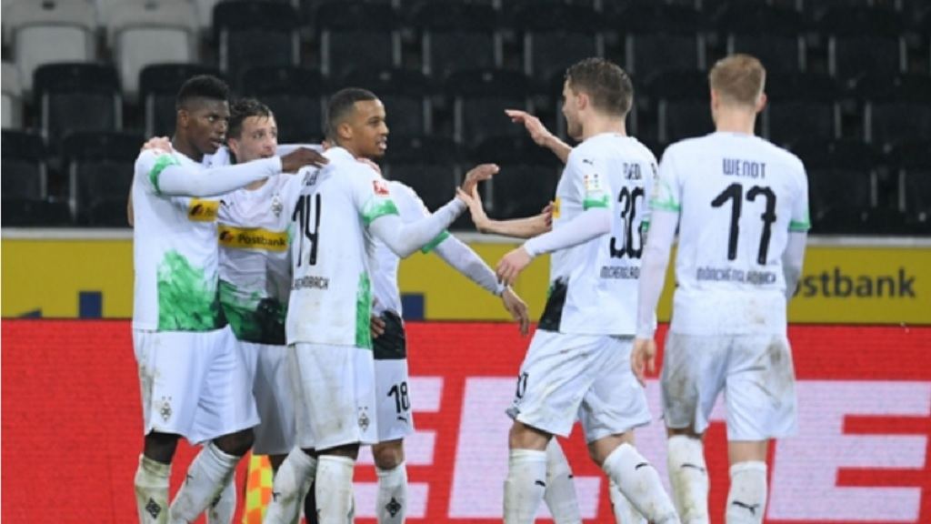 Borussia Monchengladbach celebrate during their win over Cologne, which was played behind closed doors in March.