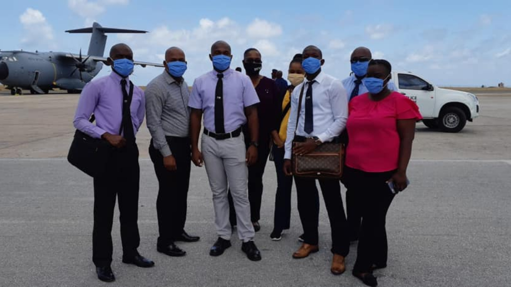Jherry Seide, Sinartra Handfield, Janefer Stubbs, Marc Kendy Charles, Shavern Ingham, Stanley Been, Isaac Isreal and Marvin Rolle pose for a group photo after they deplaned on Saturday.