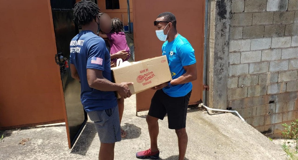 Can Bou Play's Akim Armstrong and Keston George deliver hampers.