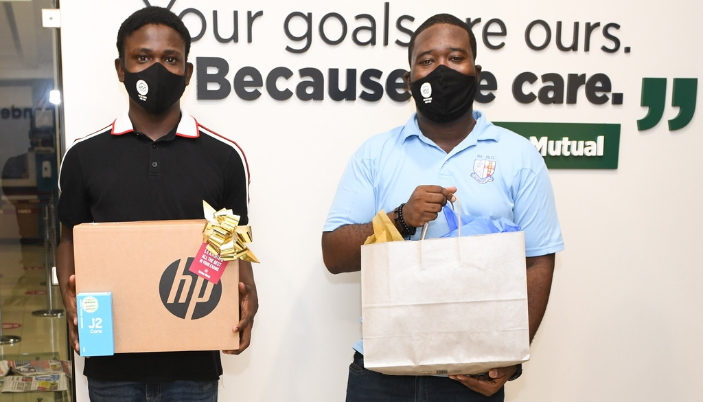 Javanah Brooks (left) with his new laptop and smartphone received from Victoria Mutual Group under its 'Labour for Learning' Labour Day initiative. With Brooks is Orane Shaw, Brooks' Physics teacher at St George's College in Kingston. Brooks was presented with the gifts on Saturday, May 23, 2020 at the VMBS Half-Way Tree Branch.