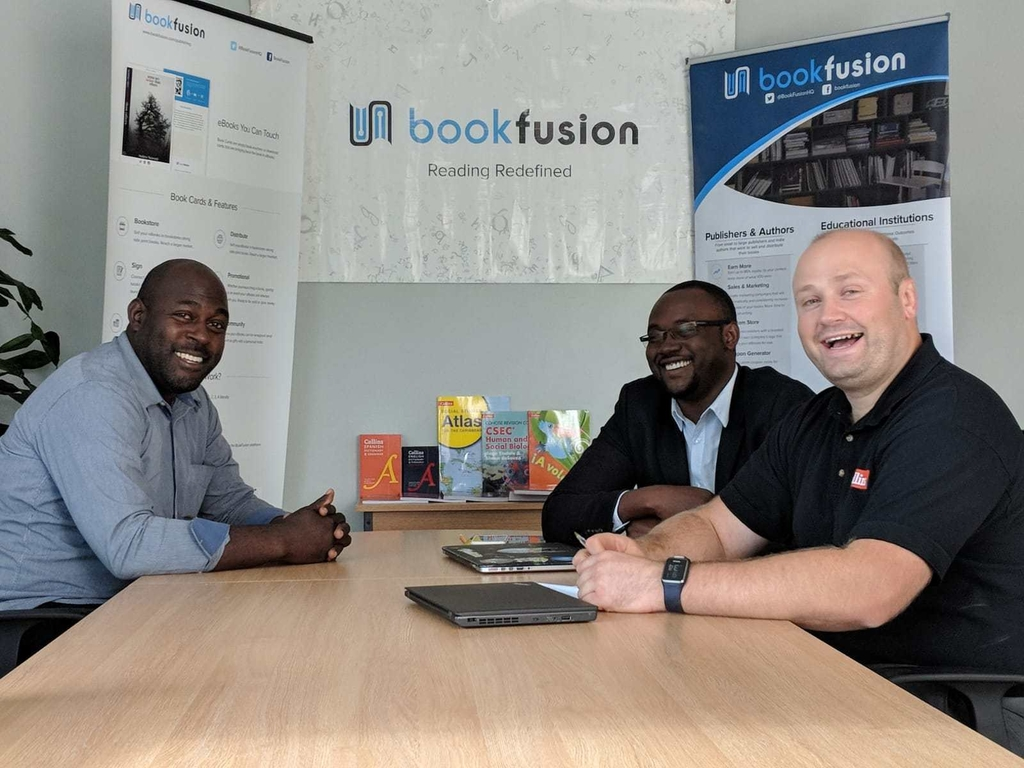 From left to right: Kevin Fullerton Marketing Representative (Jamaica) for Collins, Dwayne Campbell CEO BookFusion Limited, Tom Cane Caribbean & Africa Sales Manager for Collins.