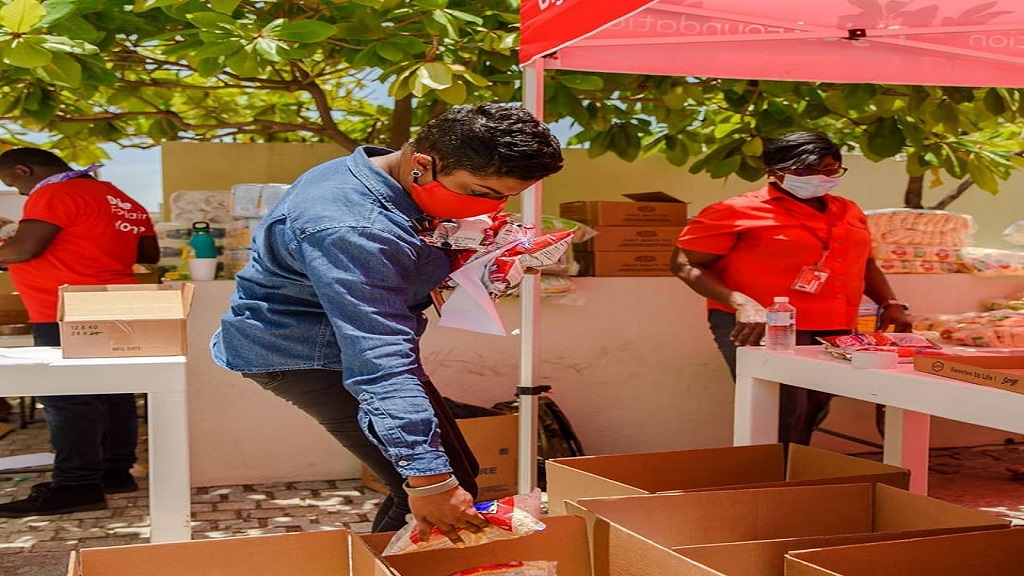 "Digicel Foundation volunteers package food items for delivery under its latest project, ""Operation SAFE Mode""."