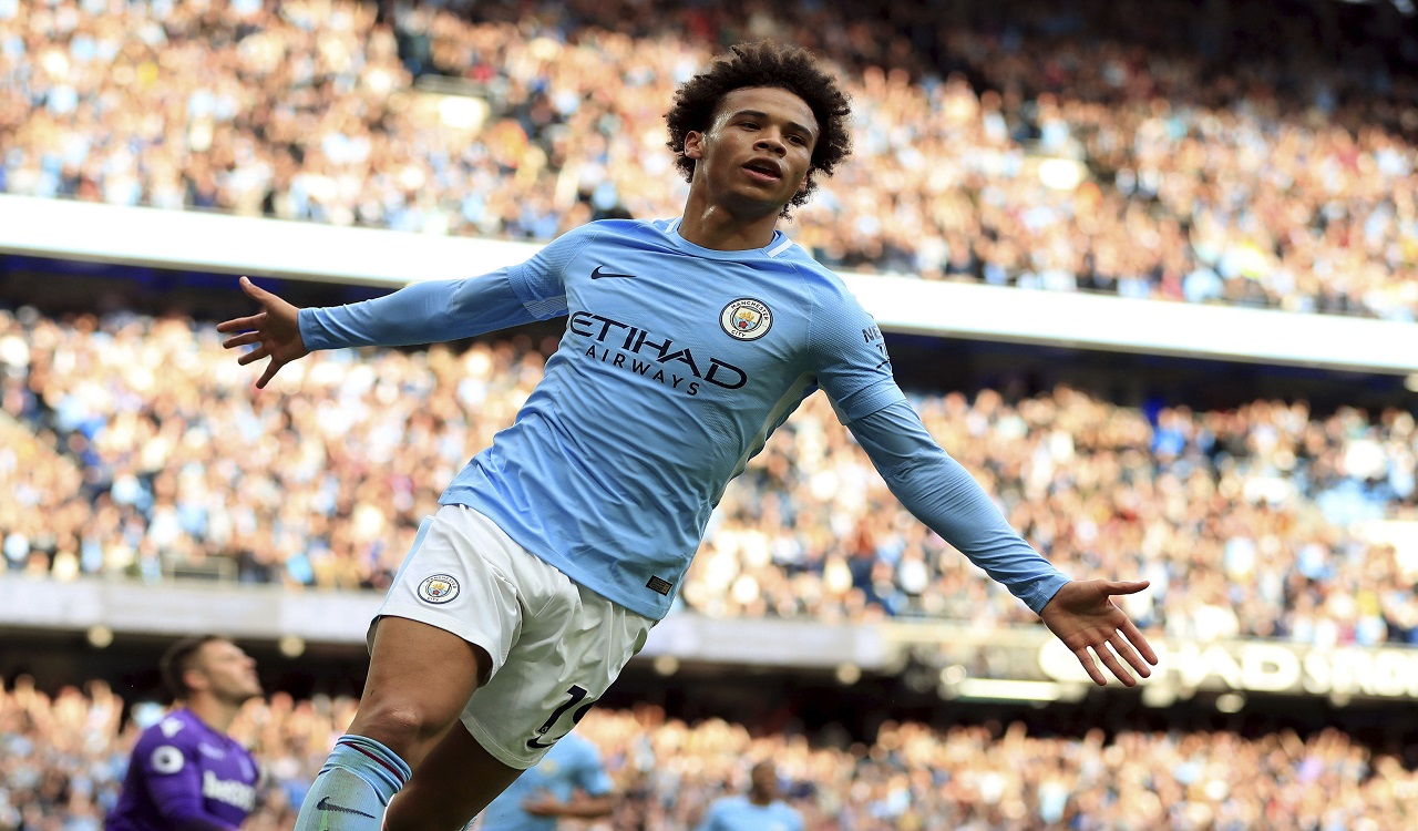 Manchester City's Leroy Sane celebrates scoring his side's sixth goal of the game during the English Premier League football match against Stoke City at Etihad Stadium, Manchester, England, Saturday, Oct. 14, 2017.