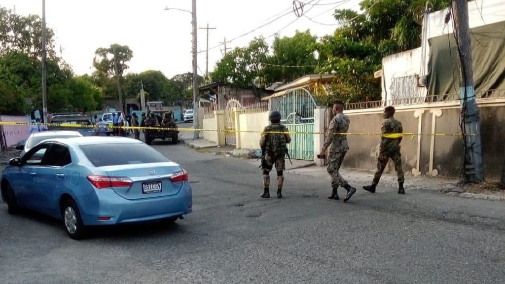 Members of the security forces at the scene of a fatal shooting reportedly during a gun battle between law enforcers and gang members in August Town, St Andrew on Wednesday afternoon.