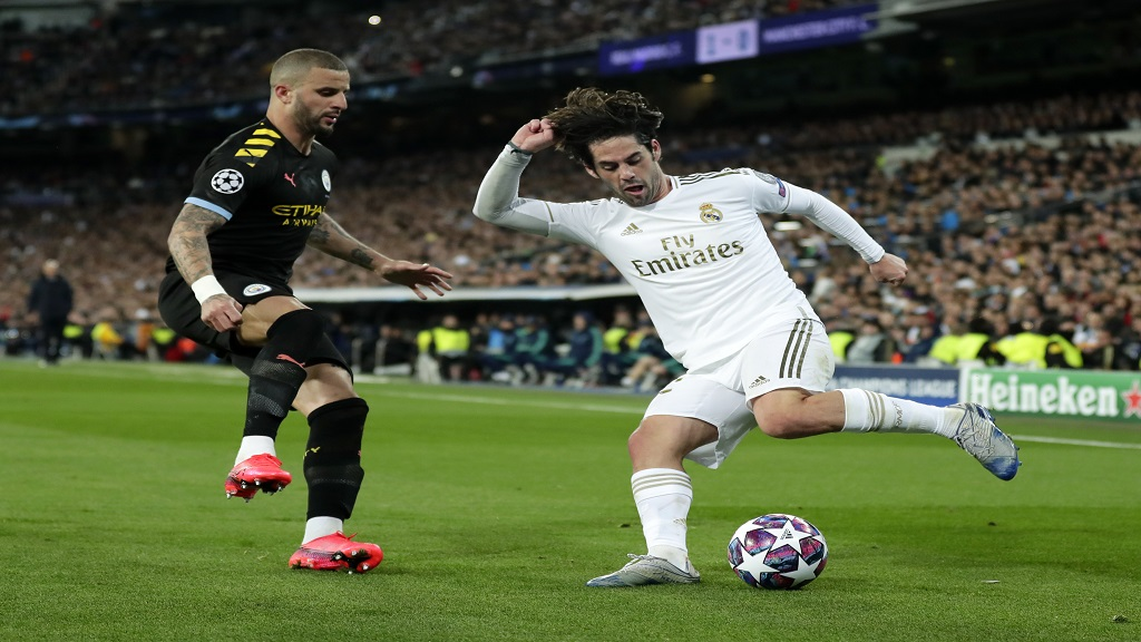 In this Wednesday, Feb. 26, 2020 file photo, Real Madrid's Isco, right, duels for the ball with Manchester City's Kyle Walker during the Champions League, round of 16, first leg football match at the Santiago Bernabeu stadium in Madrid, Spain. (AP Photo/Manu Fernandez, File).