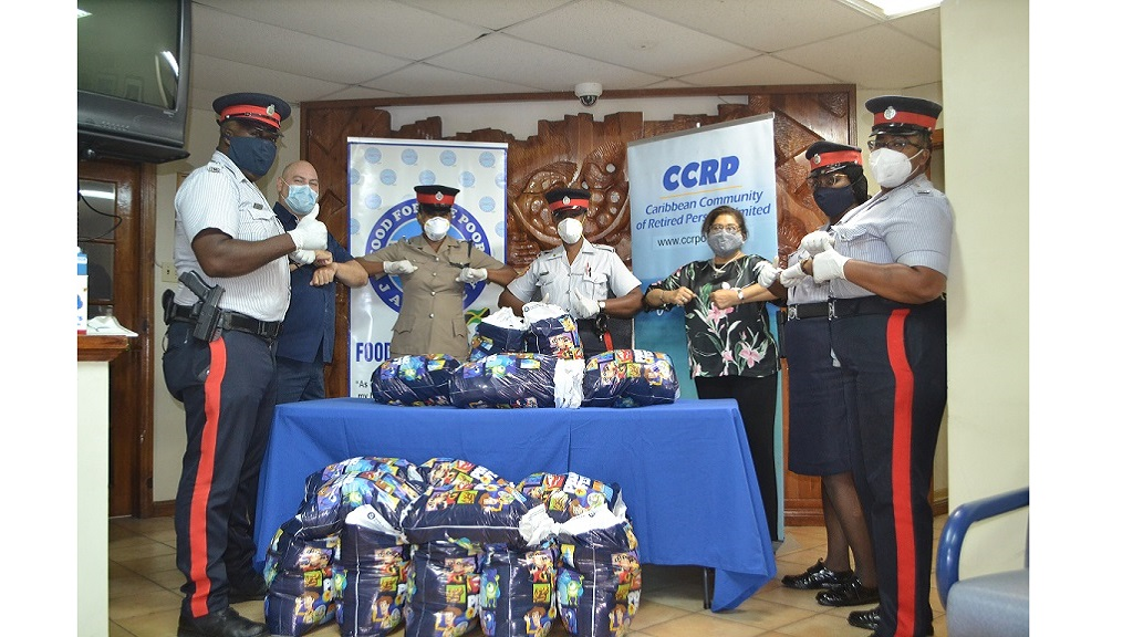 Constable Christopher Taylor (left); Craig Moss, Director at Food For The Poor Jamaica (FFPJ), Inspector Natalie Palmer-Mair, Head of the JCF Community Relations Division; Sergeant Jerr Johnson-Heron; Jean Lowrie-Chin, CCRP Executive Chair; Constable Chantal Wilson and Constable Tedisha Brown stand strong in service to the poor.