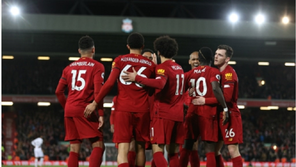 Liverpool's players celebrate a goal.