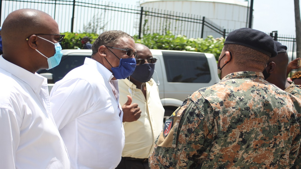 From left: North Trelawny Member of Parliament (MP), Victor Wright; Opposition Spokesman on Tourism, Dr Wykeham McNeill; and Opposition Spokesman on National Security, Fitz Jackson, in dialogue with members of the Jamaica Defence Force (JDF) outside the Falmouth Cruise Ship Pier in Trelawny on Tuesday.