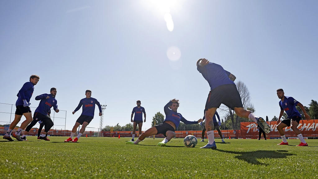 In this photo provided by Atletico Madrid, team players take part in the first group training session in Madrid, Spain, on Monday May 18, 2020. All Spanish league clubs can begin group training sessions this week despite stricter lockdown restrictions remaining in place in parts of Spain because of the coronavirus pandemic. (Atletico de Madrid via AP).