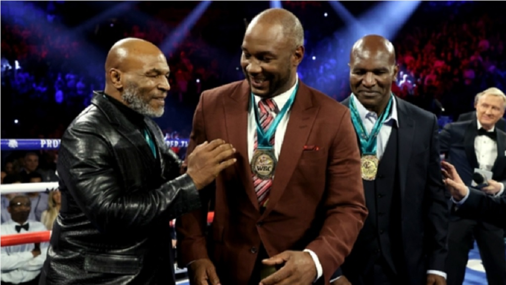 Mike Tyson (left) with his former rival Lennox Lewis in February.