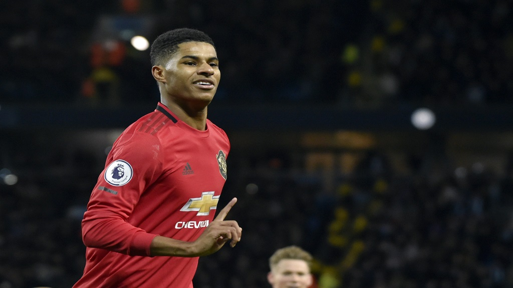 In this Saturday, Dec. 7, 2019 file photo, Manchester United's Marcus Rashford during their English Premier League football match against Manchester City at Etihad stadium in Manchester, England. Paul Pogba and  Rashford are expected to be available for Manchester United whenever the Premier League is allowed to resume after its suspension because of the coronavirus outbreak.  (AP Photo/Rui Vieira, file).