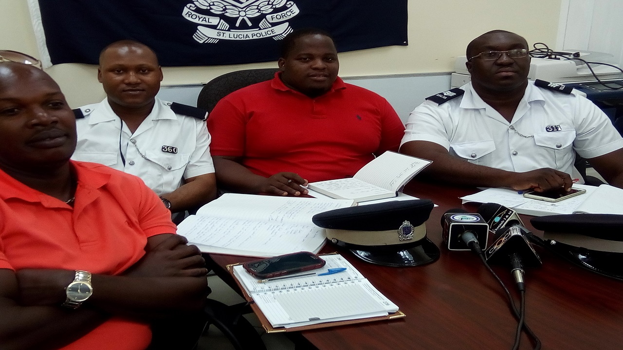 Police Welfare Association President Travis Chicot (center)