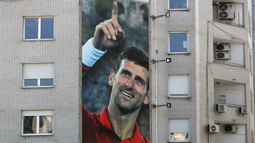 A billboard depicting Serbian tennis player Novak Djokovic is seen on a building in Belgrade, Serbia, Wednesday, June 24, 2020. Djokovic has tested positive for the coronavirus after taking part in a tennis exhibition series he organised in Serbia and Croatia. (AP Photo/Darko Vojinovic).