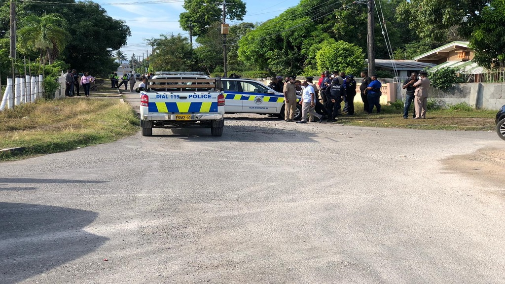 Police personnel at the scene of the shooting in Horizon Park, St Catherine two weeks ago, when two cops were fatally shot and two others injured in a battle with gunmen.