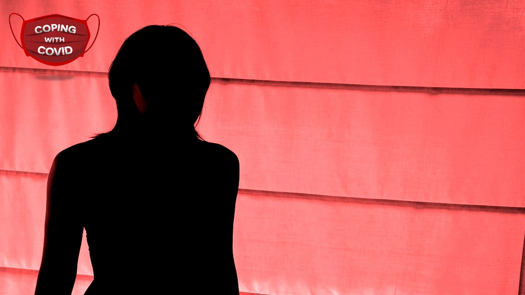 Silhouetted view of woman standing in a red light district. (Photo: iStock)