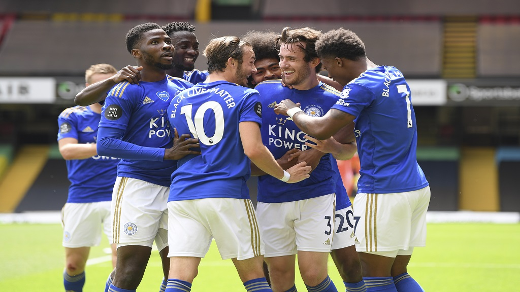 Leicester's Ben Chilwell, centre right, celebrates after scoring  during the English Premier League football match against Watford at the Vicarage Road Stadium in Watford, England, Saturday, June 20, 2020. (Andy Rain/Pool via AP).