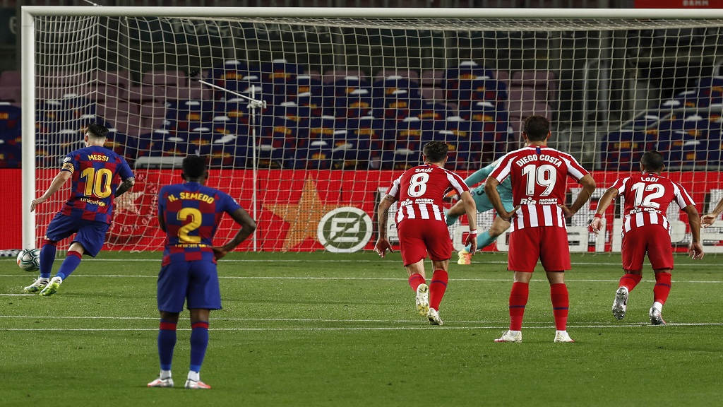 Barcelona's Lionel Messi, left, scores his side's second goal on a penalty kick during the Spanish La Liga football match against Atletico Madrid at the Camp Nou stadium in Barcelona, Spain, Tuesday, June 30, 2020. (AP Photo/Joan Monfort).