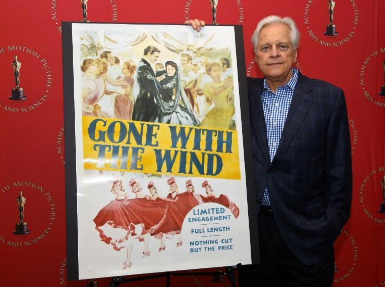 """L'affiche du film """"Autant en emporte le vent"""", et l'acteur Robert Osborne, avant une projection à New York en 2009 afp.com - Astrid Stawiarz"""