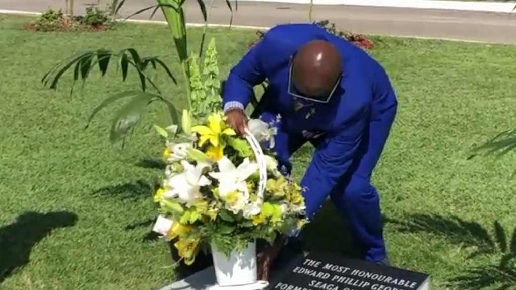 Local Government Minister Desmond McKenzie laying roses at the grave of late former Prime Minister Edward Seaga on Father's Day.