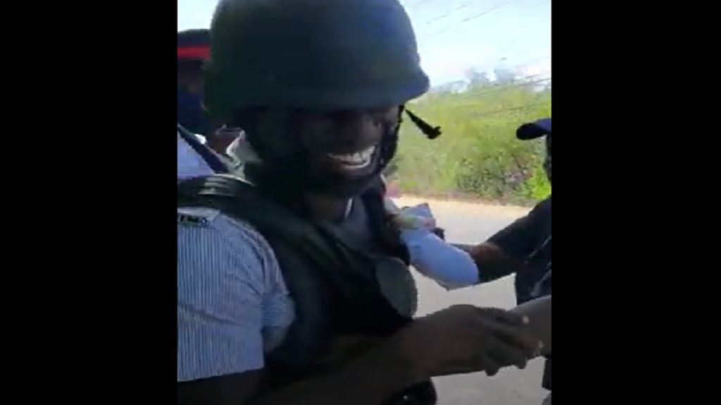 A screen grab from a video of a special presentation among a group of cops in St Catherine.