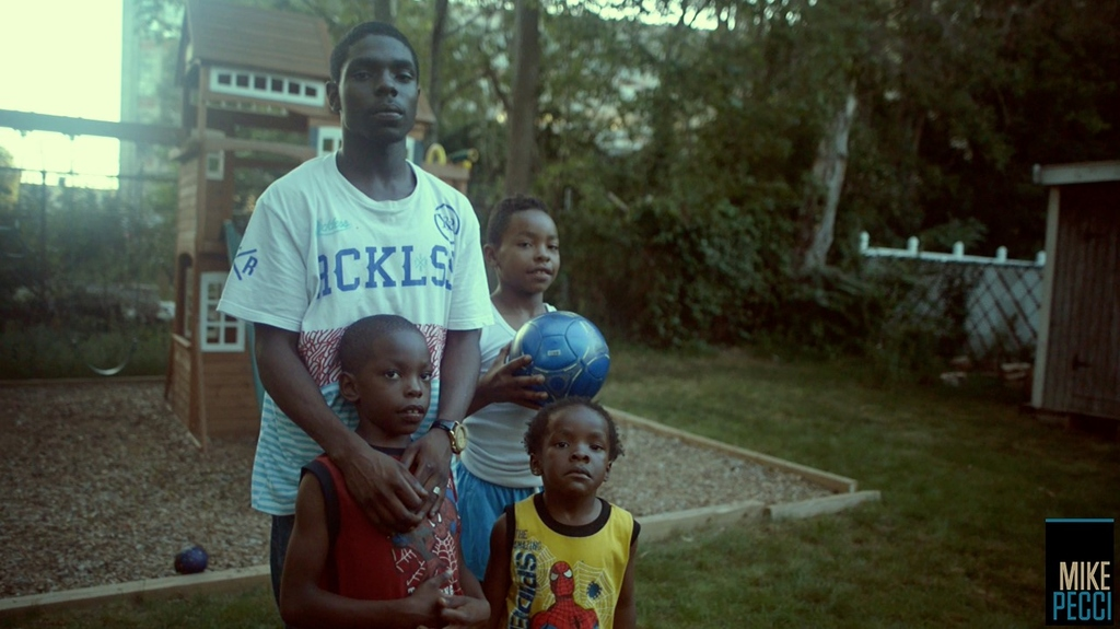 One of the young men, Dequan, from the film This Aint Normal with his three younger brothers.