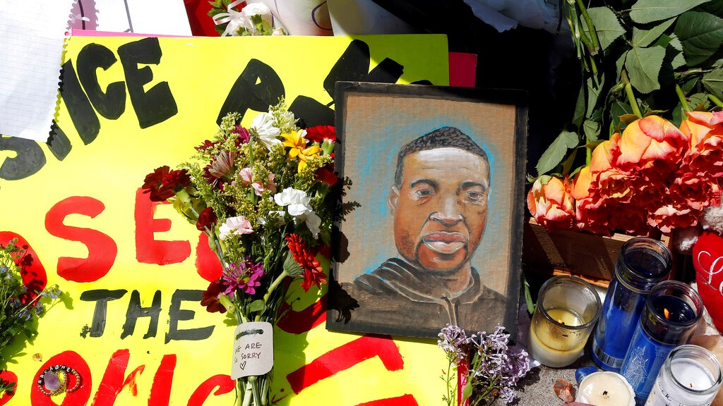 A chain portrait of George Floyd is part of the memorial for him, Wednesday, May 27, 2020, near the site of the arrest of Floyd. (AP Photo/Jim Mone)