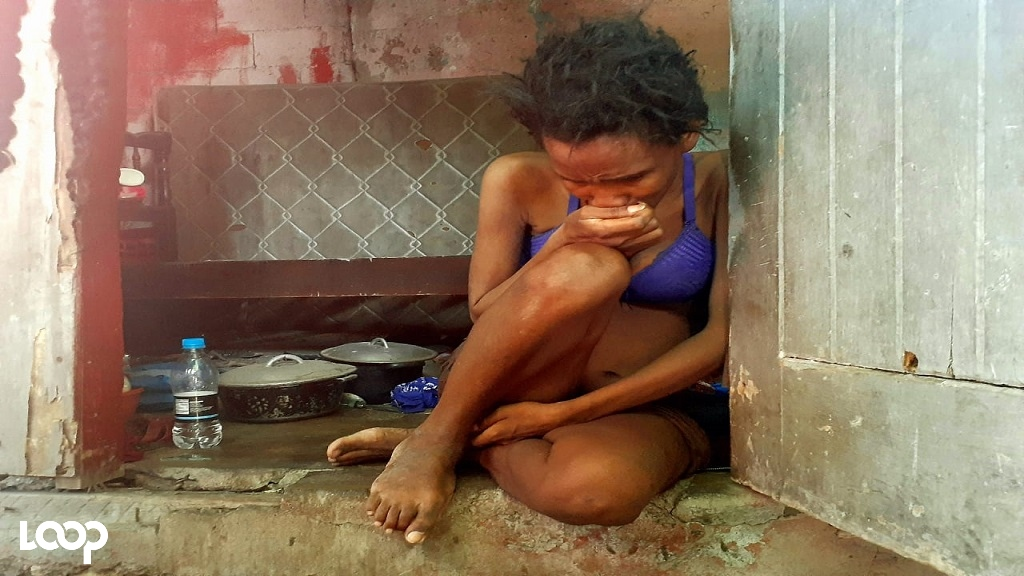 A despondent Tamika Saunders at her home during a Loop News visit earlier this week. (Photos: Marlon Reid)