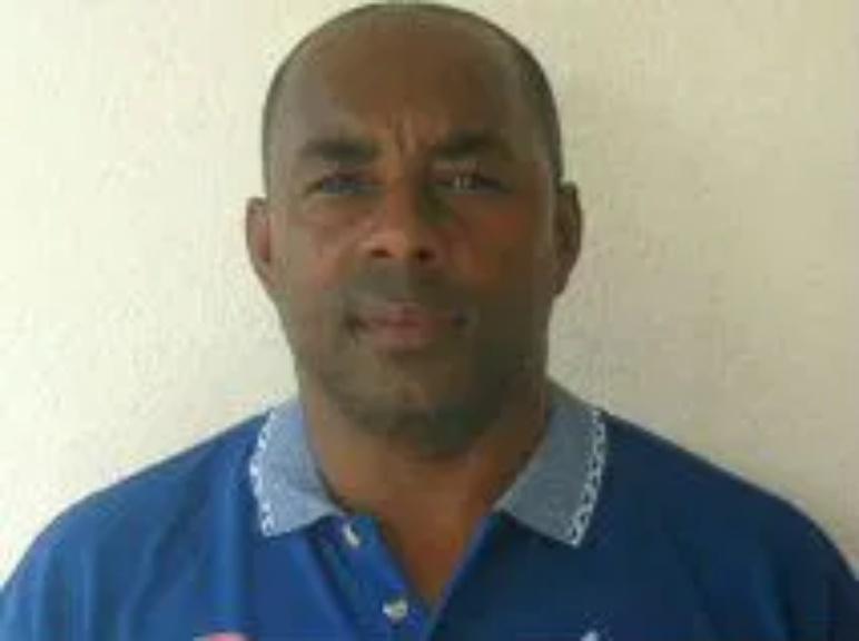 "Roland Butcher author of ""Attaining Excellence: Caribbean Soccer Manual"""