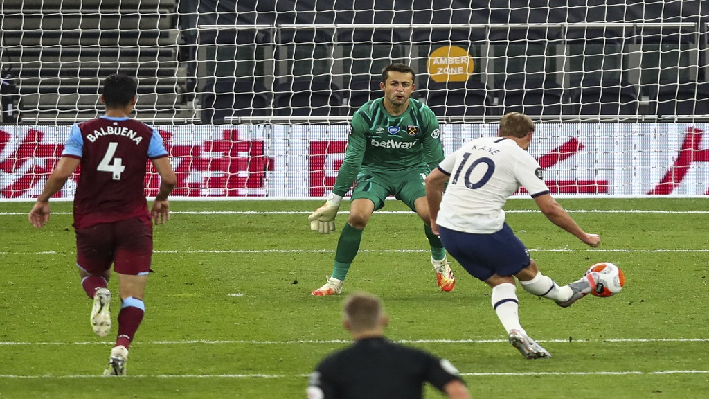 Tottenham's Harry Kane scores his team's second goal during the English Premier League football match against West Ham at the Tottenham Hotspur stadium in London, England, Tuesday, June 23, 2020. (Julian Finney/Pool via AP).