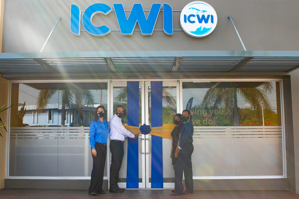 ICWI President Paul Lalor (2nd left) cuts the ribbon to officially open the company's 16th branch island-wide located at the new Super Valu Towne Centre 144, Constant Spring Road.  From left to right, Samantha Samuda, VP Marketing, Distribution & HR, Paul Lalor, President; Kasian Burrell, Customer Service Representative; and Nordia Dobbs, Branch Supervisor.