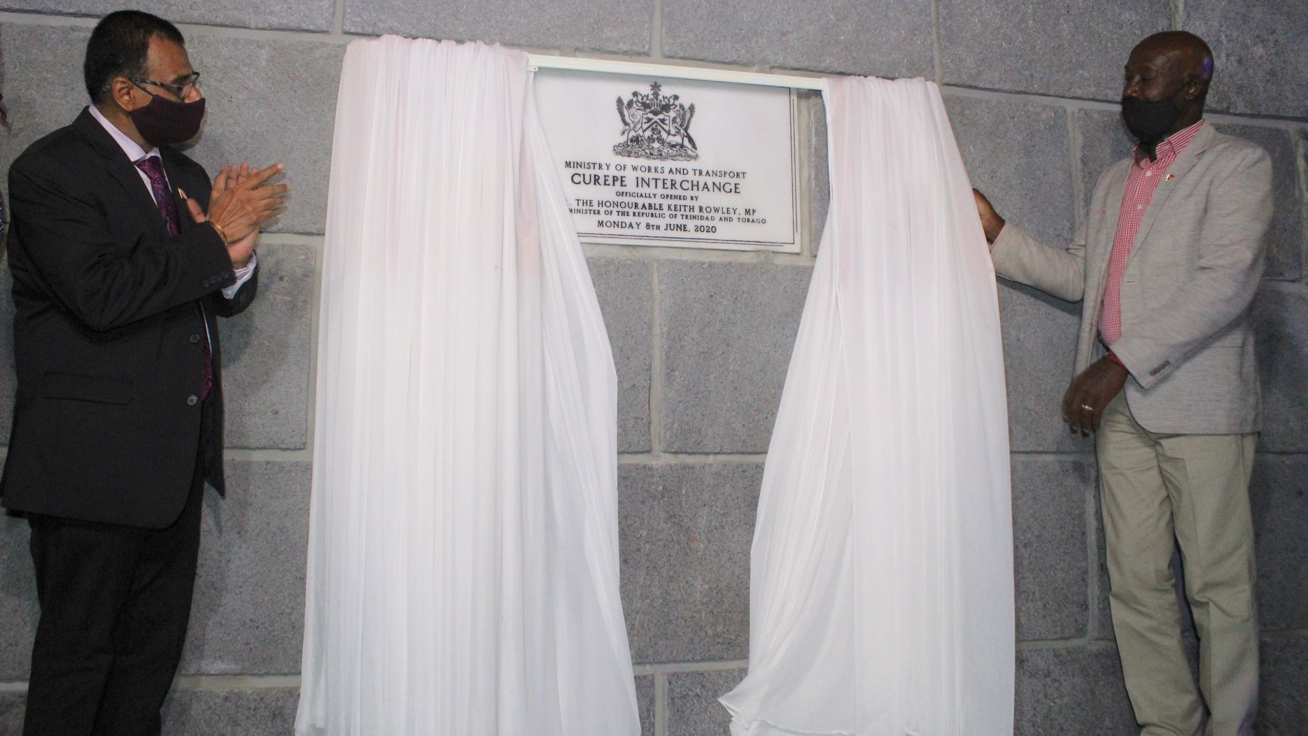 Minister of Works and Transport, Rohan Sinanan & Prime Minister Dr Keith Rowley unveil a plaque commemorating the opening of the Curepe Interchange (via Office of the Prime Minister)