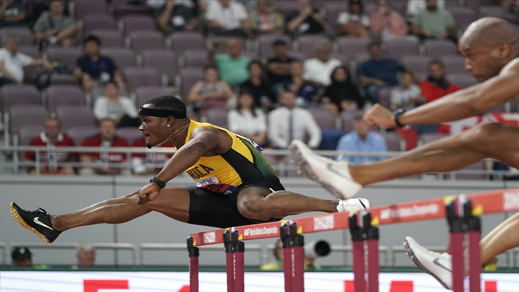 Omar Mcleod, of Jamaica, wins heat one of the men's 110m hurdles at the World Athletics Championships in Doha, Qatar, Monday, Sept. 30, 2019. (AP Photo/David J. Phillip).