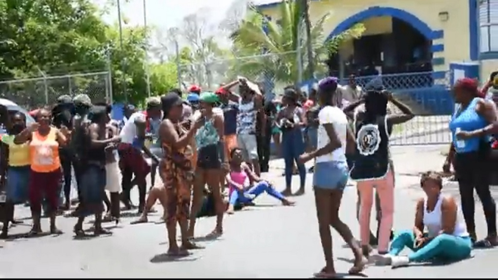 Protesters outside the Oracabessa Police Station in St Mary on Tuesday.