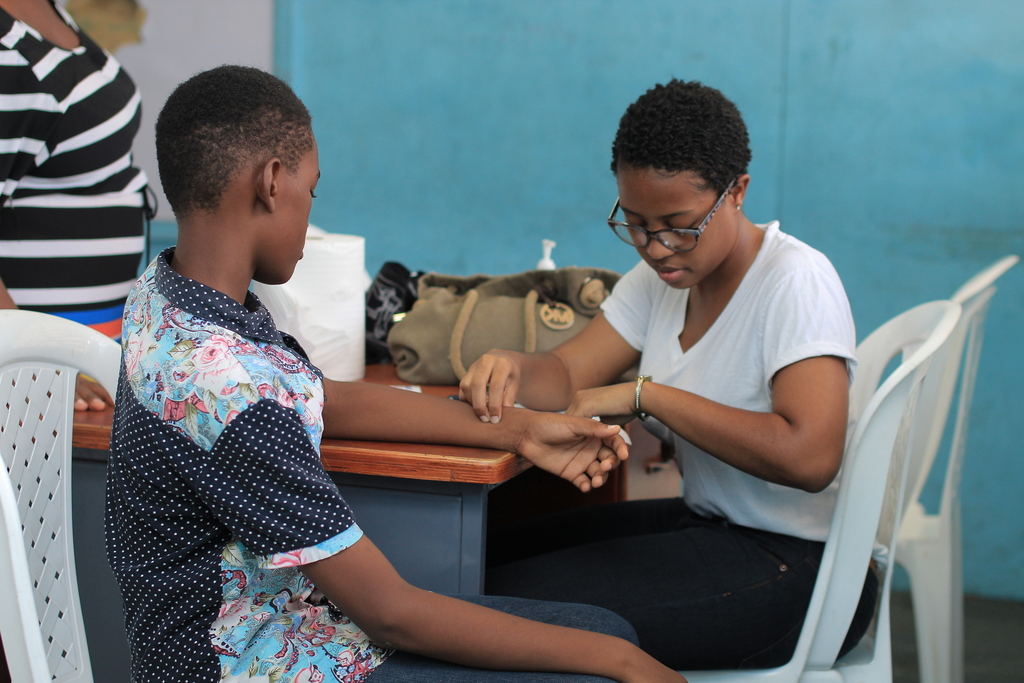 Dr Sade Dunbar, who is also a JEP past scholarship recipient, conducts a medical consultation at one of the company's past Health and Wellness Fairs. She will be part of the team of doctors at the Old Harbour Bay Primary School this Friday.
