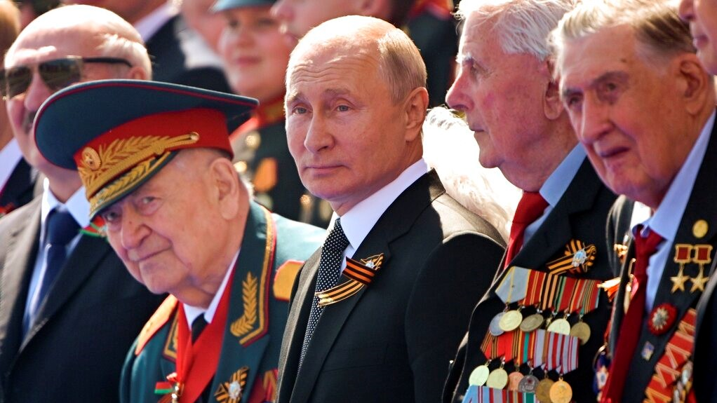 In this file photo taken on Wednesday, June 24, 2020, Russian President Vladimir Putin, center, watches the Victory Day military parade marking the 75th anniversary of the Nazi defeat in Moscow. (Sergei Guneyev, Host Photo Agency via AP, file)