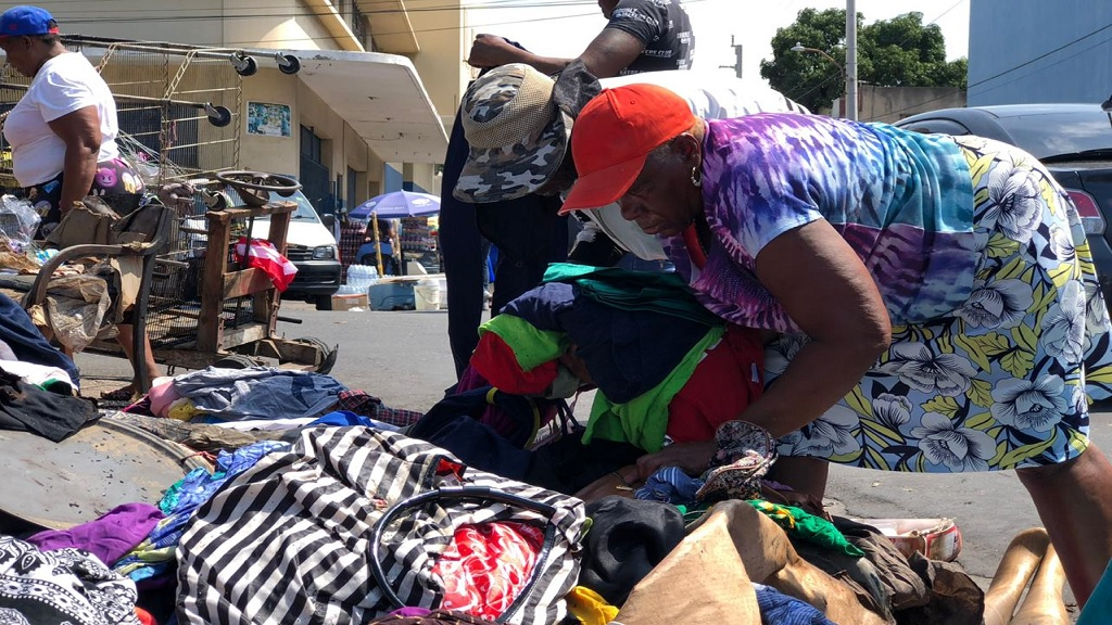 Vendors at the Ray Ray Ground Market in downtown Kingston picking up the pieces after a fire destroyed their stalls late Monday.