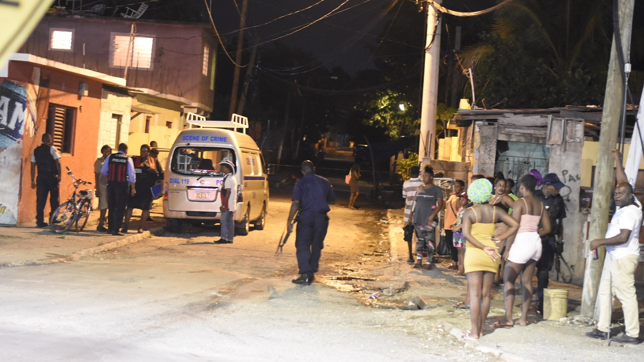 File photo of a police operation after a shooting on 100 Lane off Red Hills Road in St Andrew.