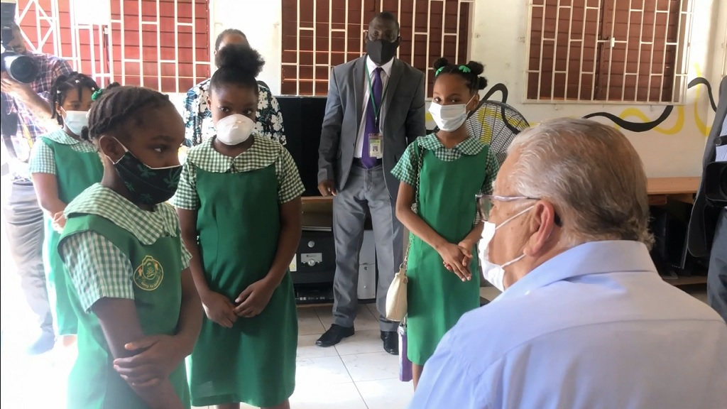 Education minister Karl Samuda engaging with students of Tulloch Primary in Bog Walk, St Catherine. The school is the latest beneficiary of internet service from Ready TV.