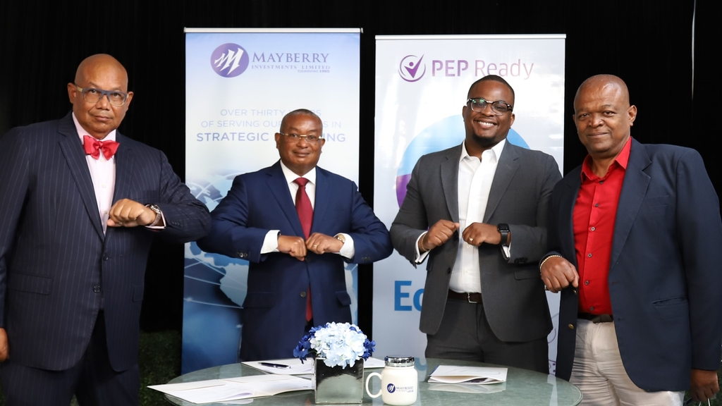 Standing firm in acknowledgement of the partnership are (from left) Mayberry Investments' Executive Chairman, Christopher Berry, Executive Vice Chairman and Company Secretary, Konrad Mark Berry, EduFocal CEO and Co-Founder, Gordon Swaby and Director, Lloyd Swaby.