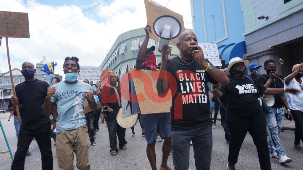 David Denny leading protestors through Bridgetown for the Black Lives Matter protest