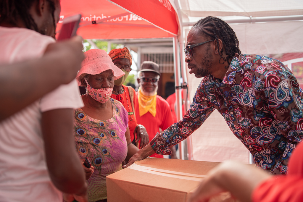 Bounty Killer makes another handover of grocery items to a resident of the Majesty Gardens community.